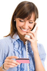 Business woman with plastic card and phone