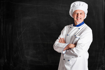 Chef in front of an empty blackboard