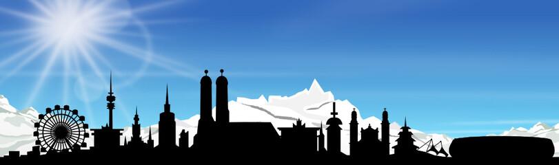 München Skyline mit Alpen und blauem Himmel