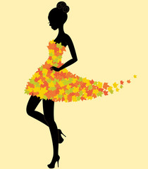 Dancer girl in dress of autumn leaves