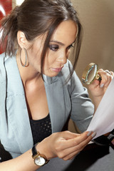 woman looks on one document