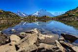 Mountain lake reflection in summer in the French Alps
