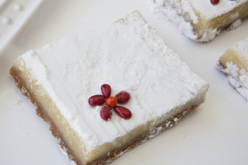 Lemon Bar closeup with red flower accent