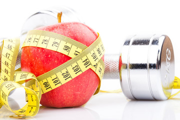 fitness equipment and red apple