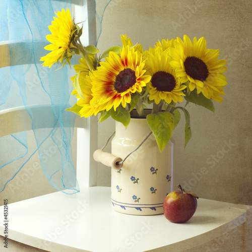 Beautiful  sunflower bouquet with apple