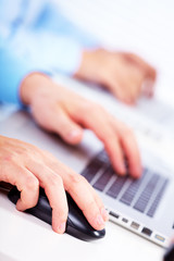 Hand with a computer mouse.