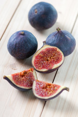 Still life food: figs on wooden boards