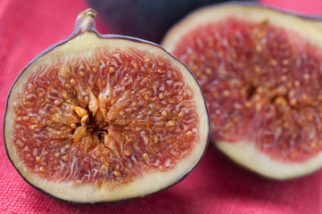 Close-up of fig fruit halves on a red serviette, horizontal shot