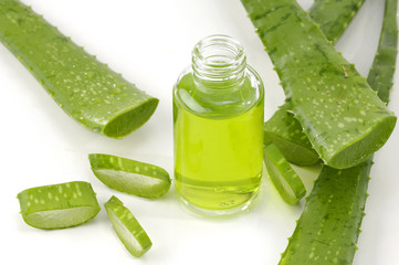 Aloe vera with bottle of cosmetic