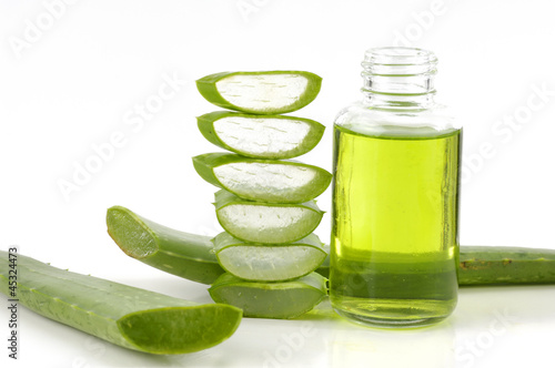 bottle of cosmetic with fresh aloe vera