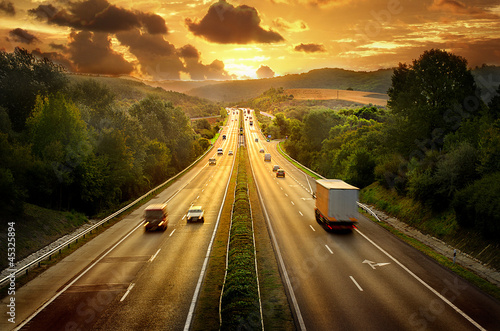 canvas print picture Highway trafin in sunset