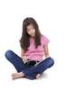 Little girl sitting on floor reading a magazine
