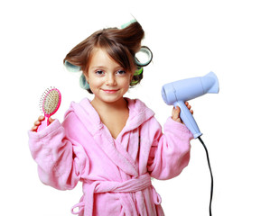Girl with a comb in hair curlers