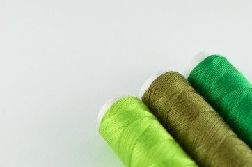 Green yarn on white background