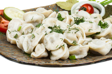 Bowl with traditional russian dish - pelmeni
