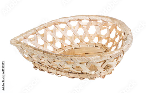 Wickerwork empty yellow breadbasket on white background