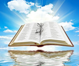 Bible with blue sky and white clouds