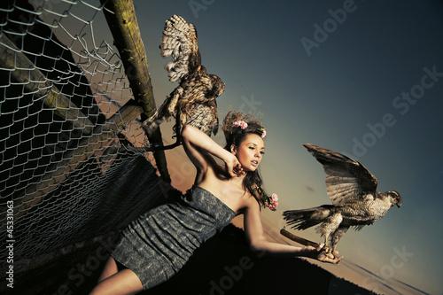 Elegance lady holding eagles - 45331063