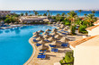 the pool, beach umbrellas and the Red Sea in Egypt