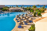 the pool, beach umbrellas and the Red Sea in Egypt - 45332852