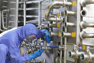 technician fixing valves in plant