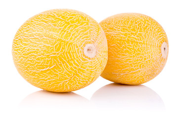 Two whole fresh honeydew melon isolated on a white background