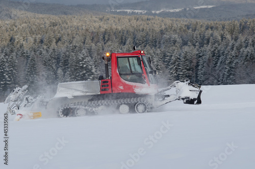 Snowplow in the mountain