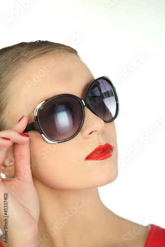 Attractive blond woman posing in sunglasses