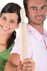 Couple holding rolling pin