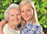 Grandmother and granddaughter. Senior and young woman outdoors.