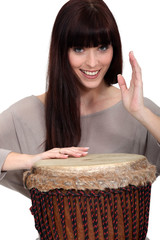 Woman playing percussion.