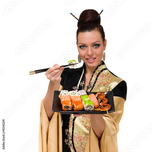 Woman wearing a traditional dress eating sushi
