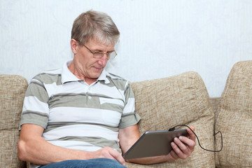 Modern toys as touchpad in the hands of senior adult man