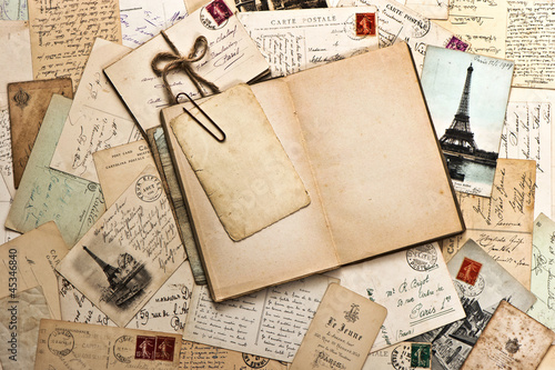 old papers, french post cards and open diary book
