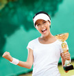 Female tennis player won the cup at the competition. Victory