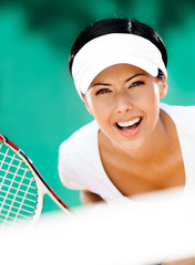 Woman in sportswear playing tennis. Tournament. Close up