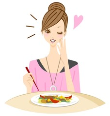 おいしい料理を食べる女性