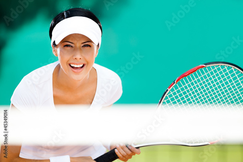 Woman in sportswear playing tennis. Tournament