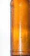 Wet bottle of Beer on white