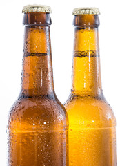 Two wet bottles of Beer on white