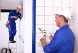 Two electricians working