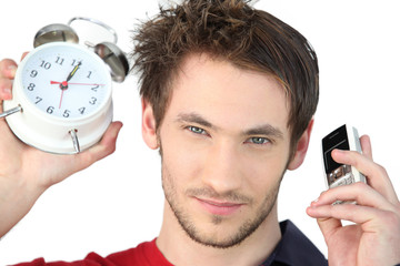 Man stood alarm clock and mobile