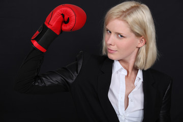 Businesswoman with a boxing glove