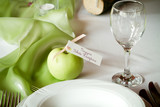 wedding tables set for fine dining, green apple poster