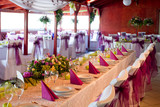 wedding tables set for fine dining or another catered event poster