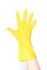 hand with yellow glove - isolated on white background