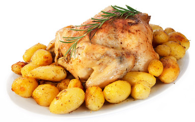 Delicious roast chicken with potatoes on white background