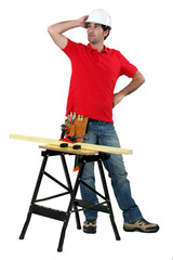 carpenter with workbench looking puzzled