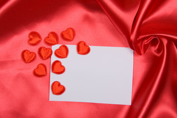 White card for congratulation on red silk