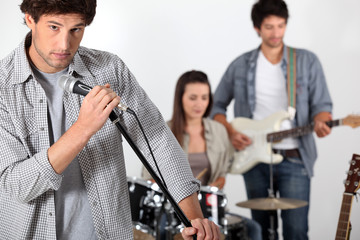 Rock band rehearsing